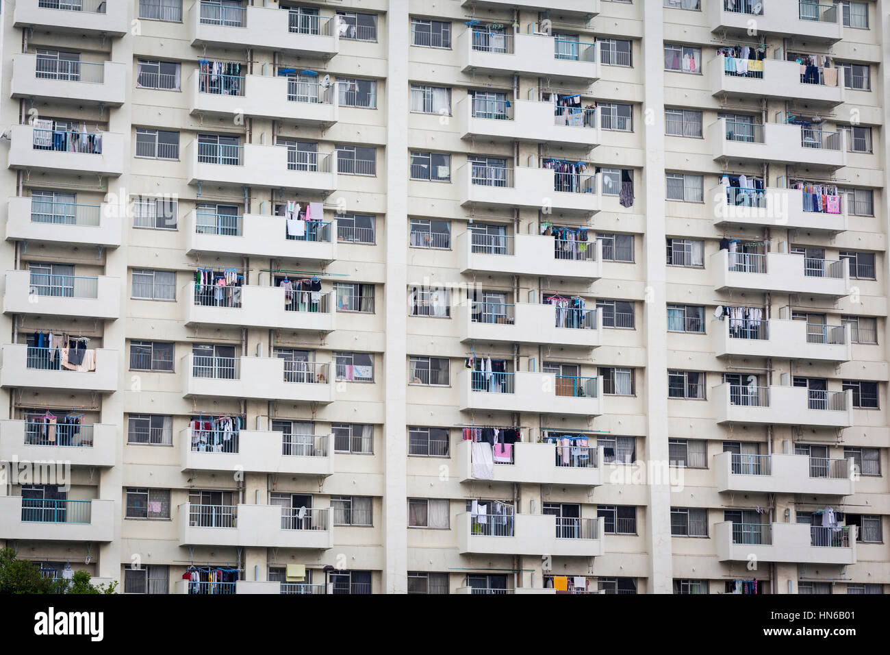 TOKYO- MAY 25: A basic, residential tower block in the Tsukiji district of Tokyo on 25th May 2012. The rows of windows - Stock Image