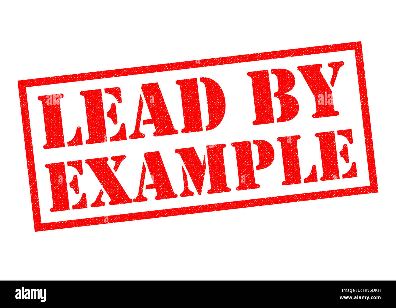 lead by example red rubber stamp over a white background stock photo