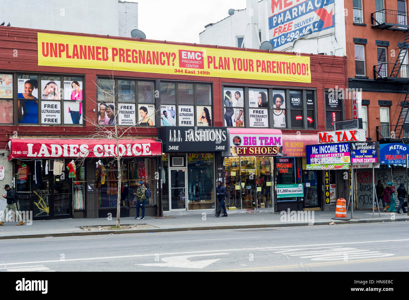 An EMC Frontline Pregnancy Center (Expectant Mother Care) above other businesses in the the Hub, in the Melrose - Stock Image