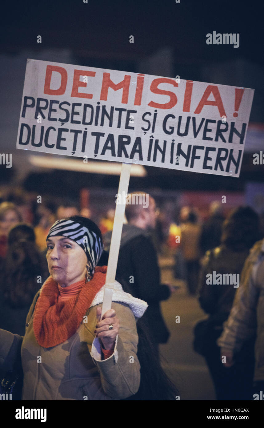 Bucharest, Romania - October 6, 2013: Adult woman holds a slogan placard during the mass riot against the cyanide gold extraction in Rosia Montana Stock Photo