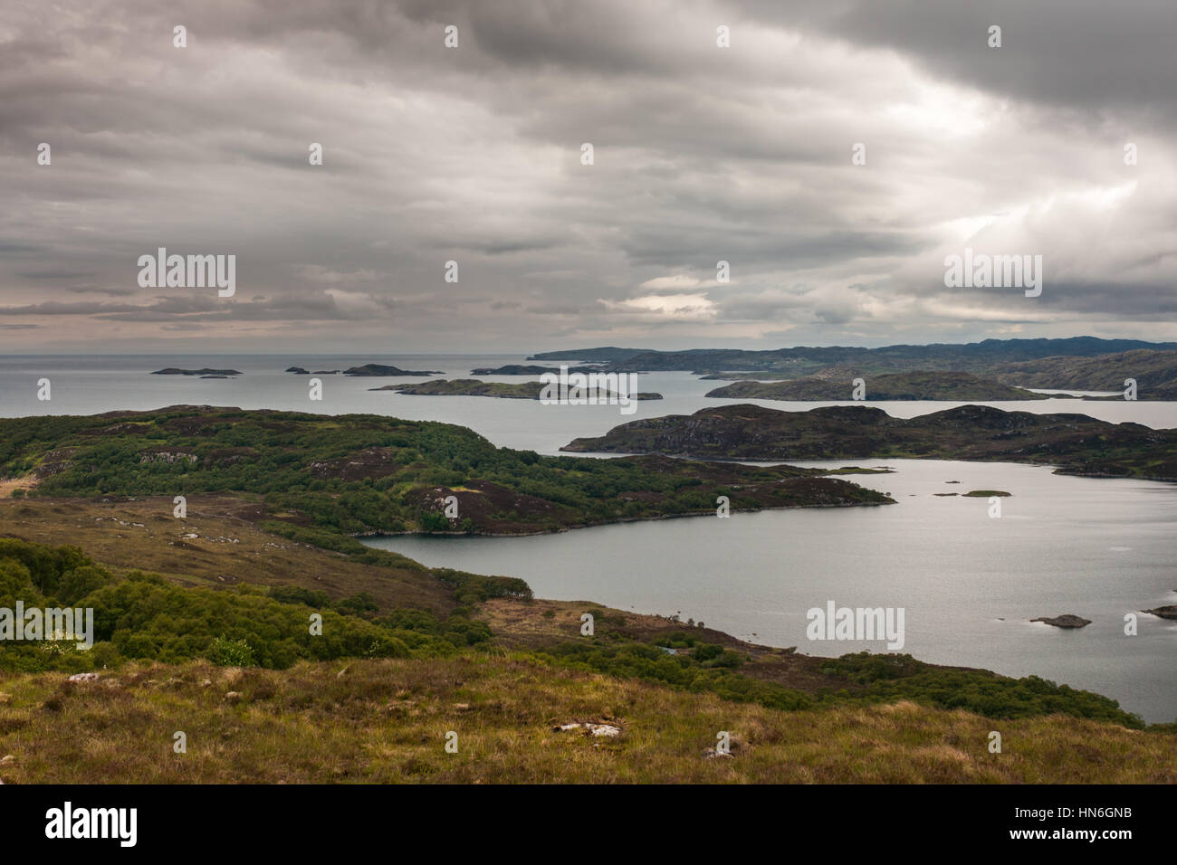 Assynt Peninsula, Scotland - June 7, 2012: Under dark cloudy sky aerial view on Loch Ardhair with intrusion of the - Stock Image