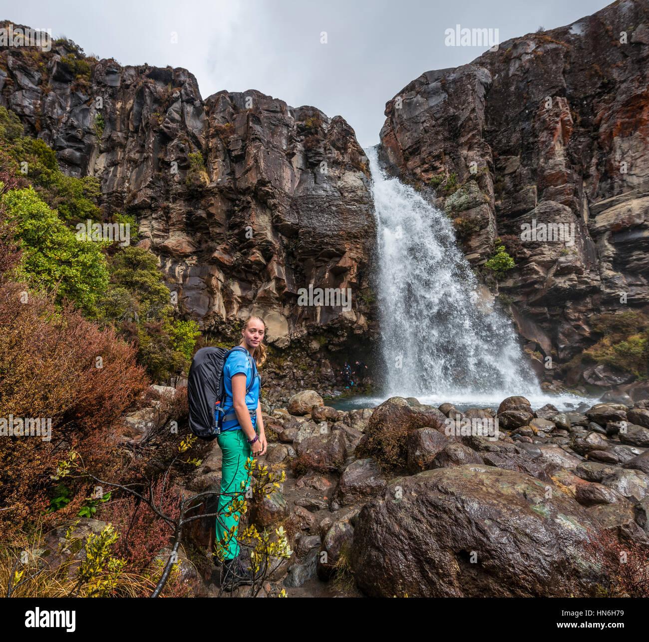 Hiker the Taranaki Falls, waterfall, Tongariro National Park, North Island, New Zealand - Stock Image