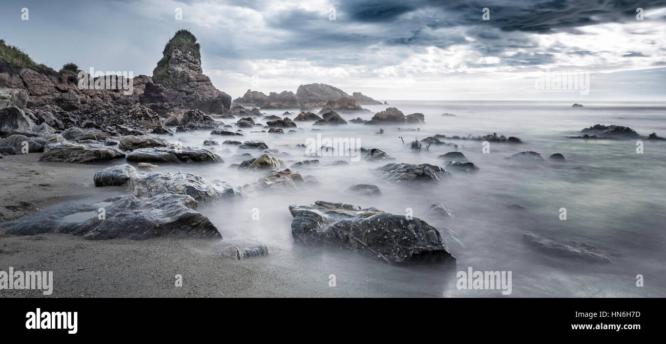 Beach, rain clouds, West Coast Region, Southland, New Zealand - Stock Image