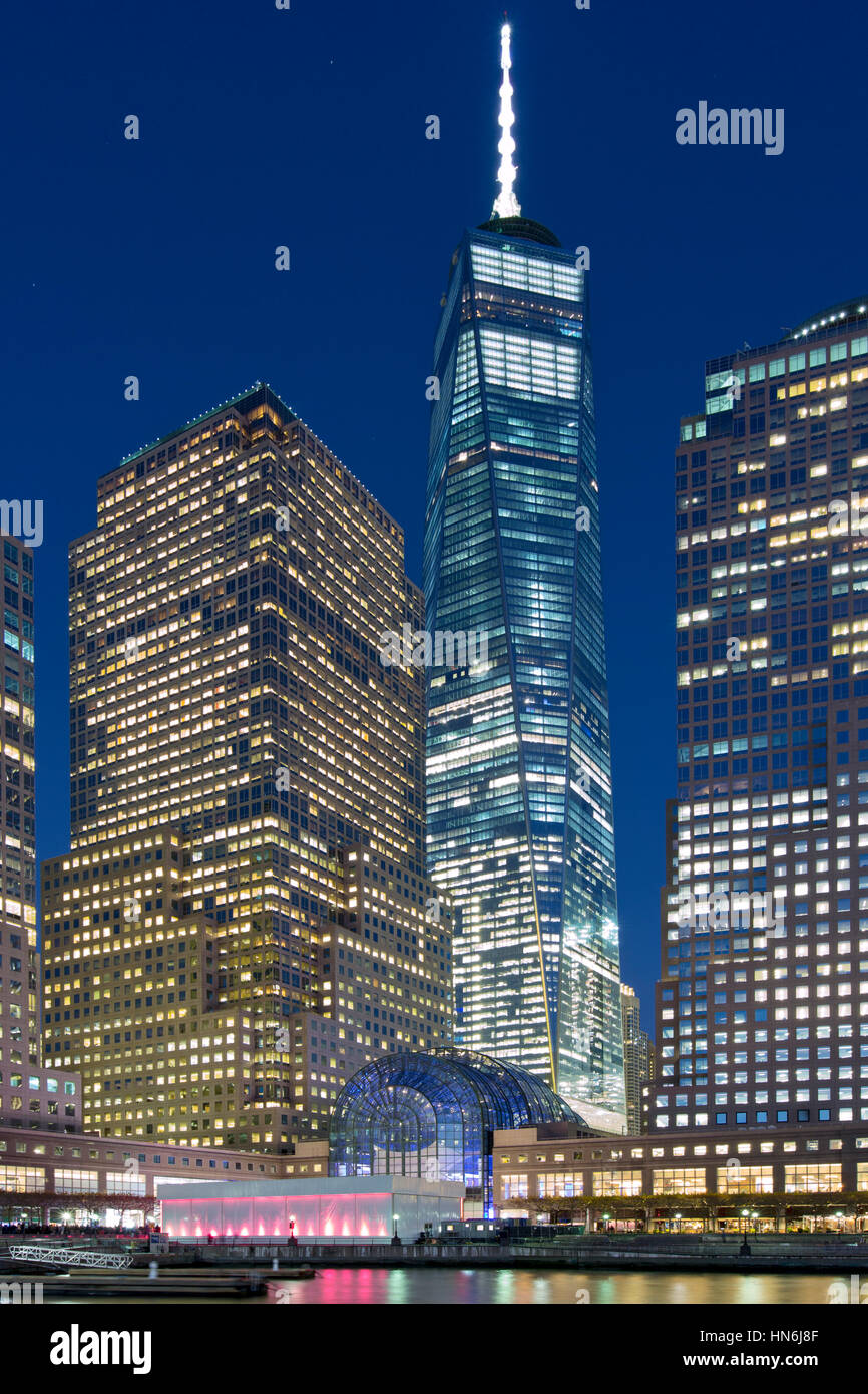 New York Financial Center at dusk and One World Trade Center and the surrounding business district. - Stock Image