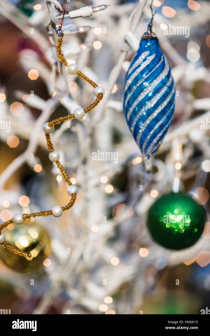 Blue Green And Gold Christmas Tree Ornaments With Lights On A White Stock Photo Alamy