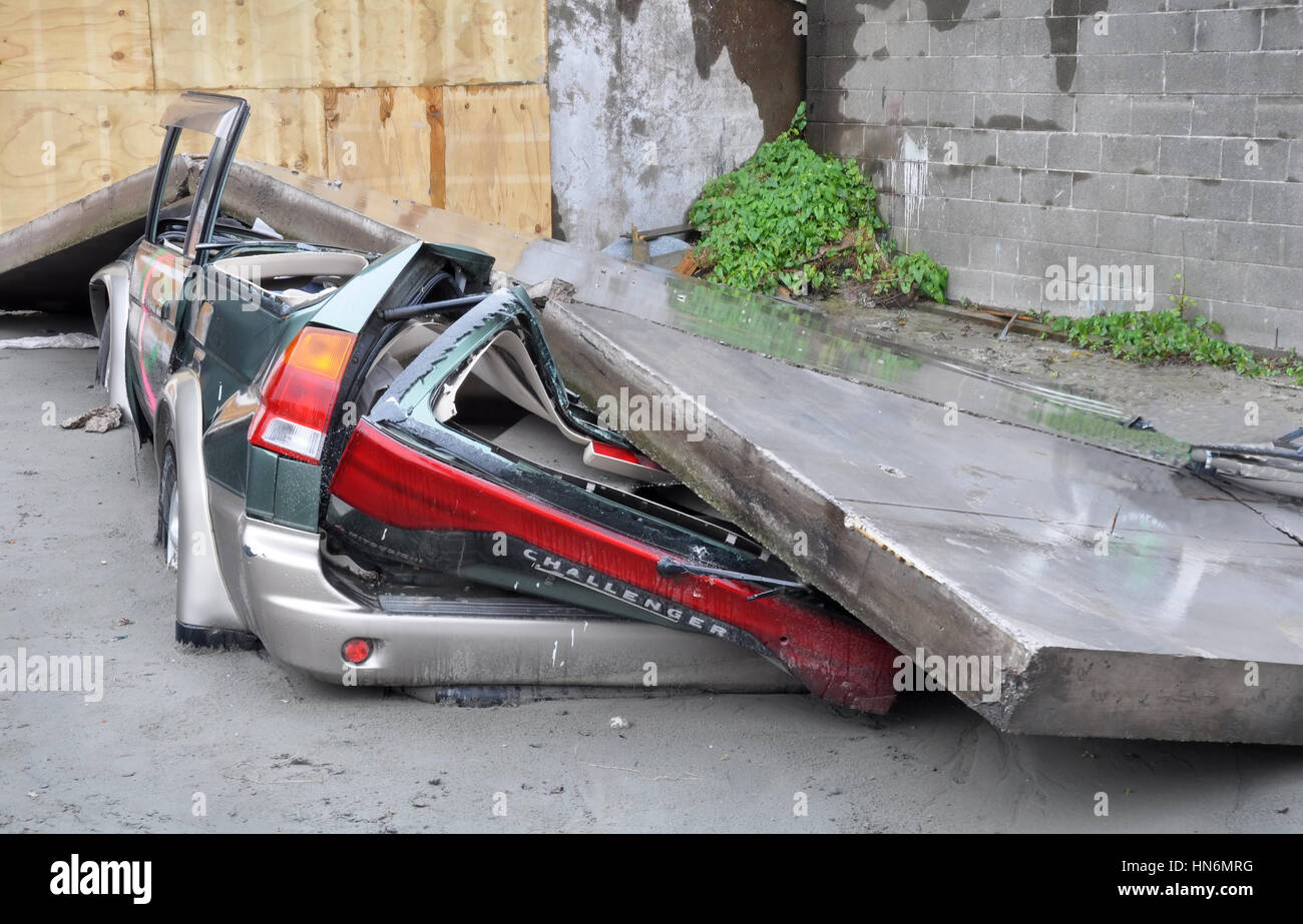 Christchurch, New Zealand - March 2011: A car is crushed by a collapsed concrete wall on March 20, 2011 in Christchurch - Stock Image