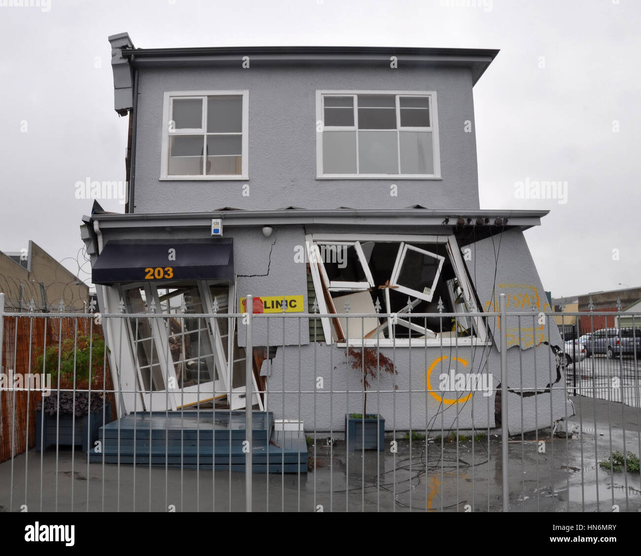 Christchurch, New Zealand - March 20, 2011: A house in the east of the city leans precariously after the 22 Februray Stock Photo