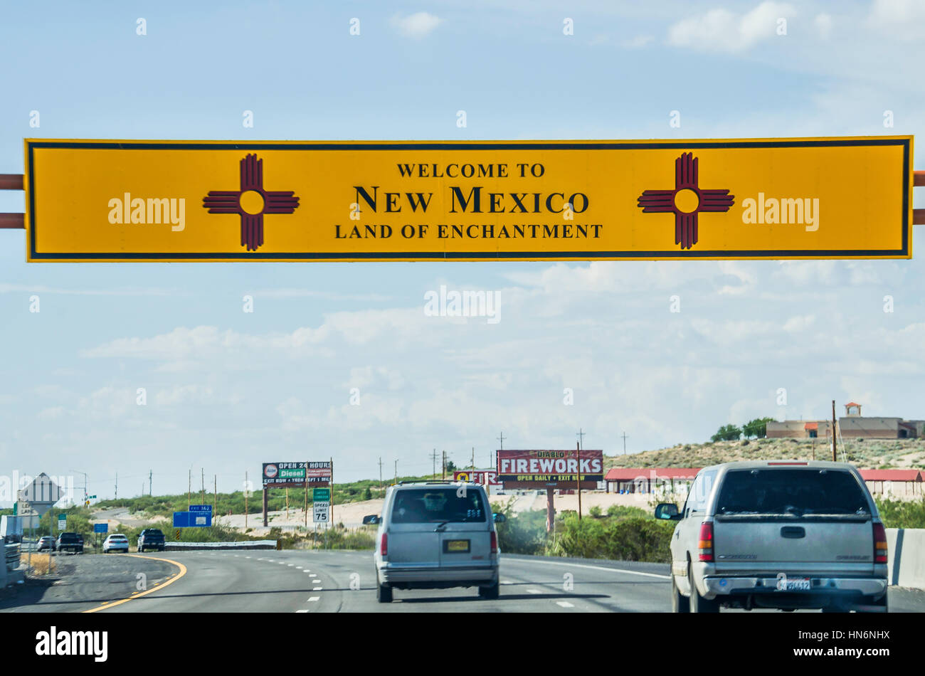 El Paso, USA - July 26, 2015: Welcome to New Mexico sign with land of enchantment words on highway at Texas border Stock Photo