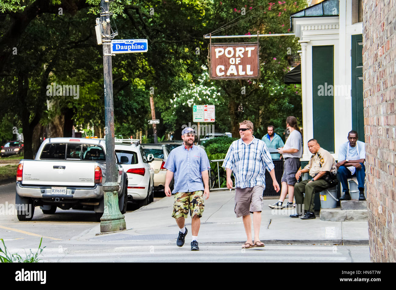 New Orleans - July 13, 2015: People walking on historic Dauphine district during daytime with port of call sign Stock Photo