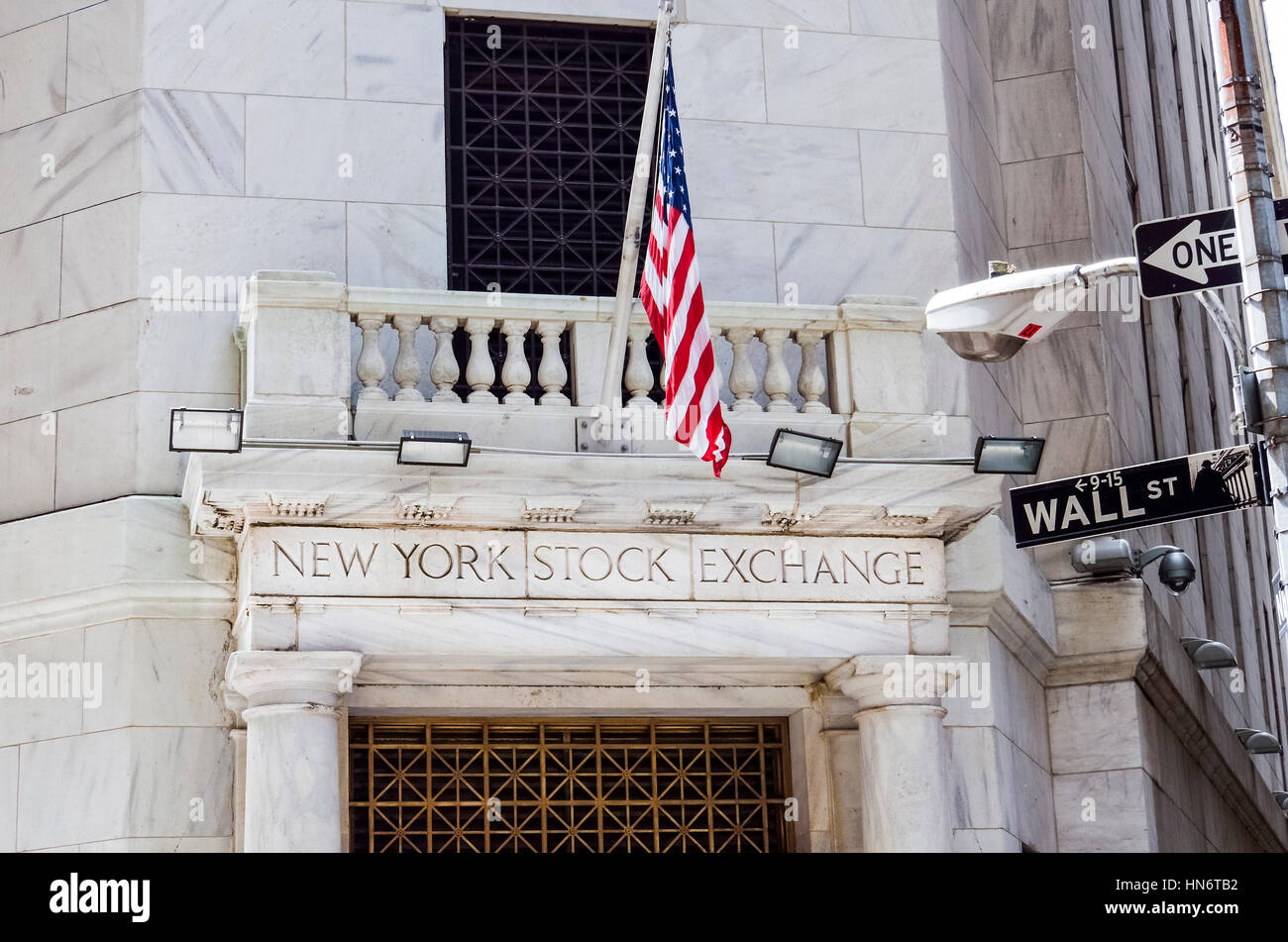 New York, USA - June 18, 2016: New York Stock Exchange with American flags and Wall street sign - Stock Image