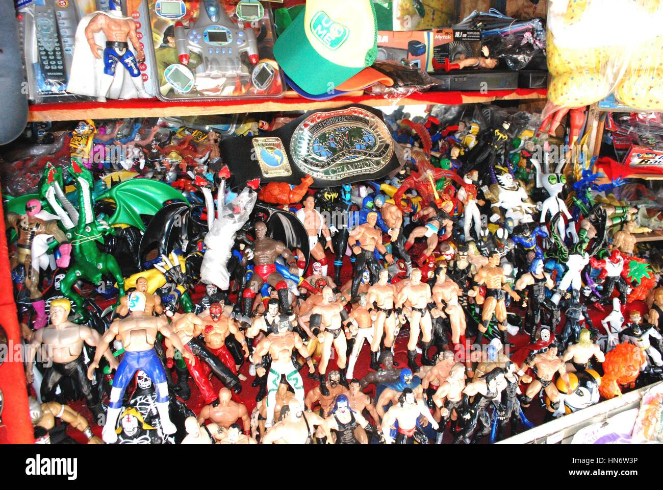 A toy stall in Mexico, full of wrestling action figures. - Stock Image