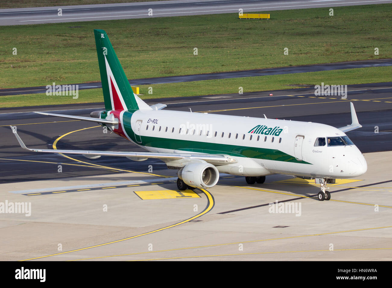 DUSSELDORF, GERMANY - DEC 21, 2015: Alitalia Cityliner Embraer ERJ-175STD taxiing after landing at Dusseldorf Airport - Stock Image