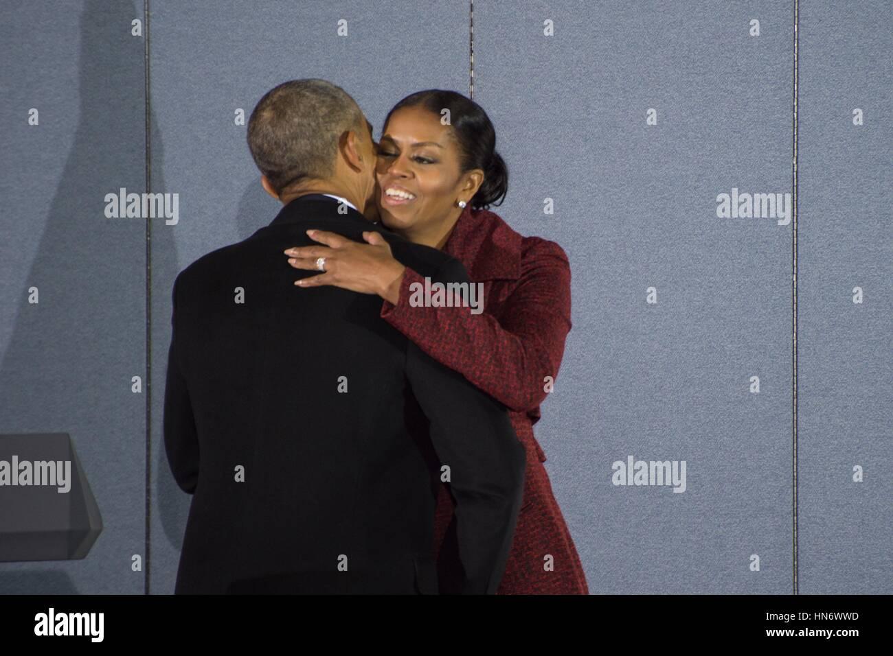 former us president barack obama hugs his wife michelle