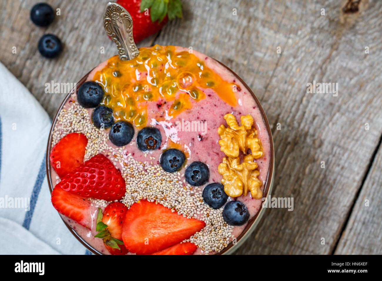 Breakfast smoothie berry bowl with chia, passion fruit and