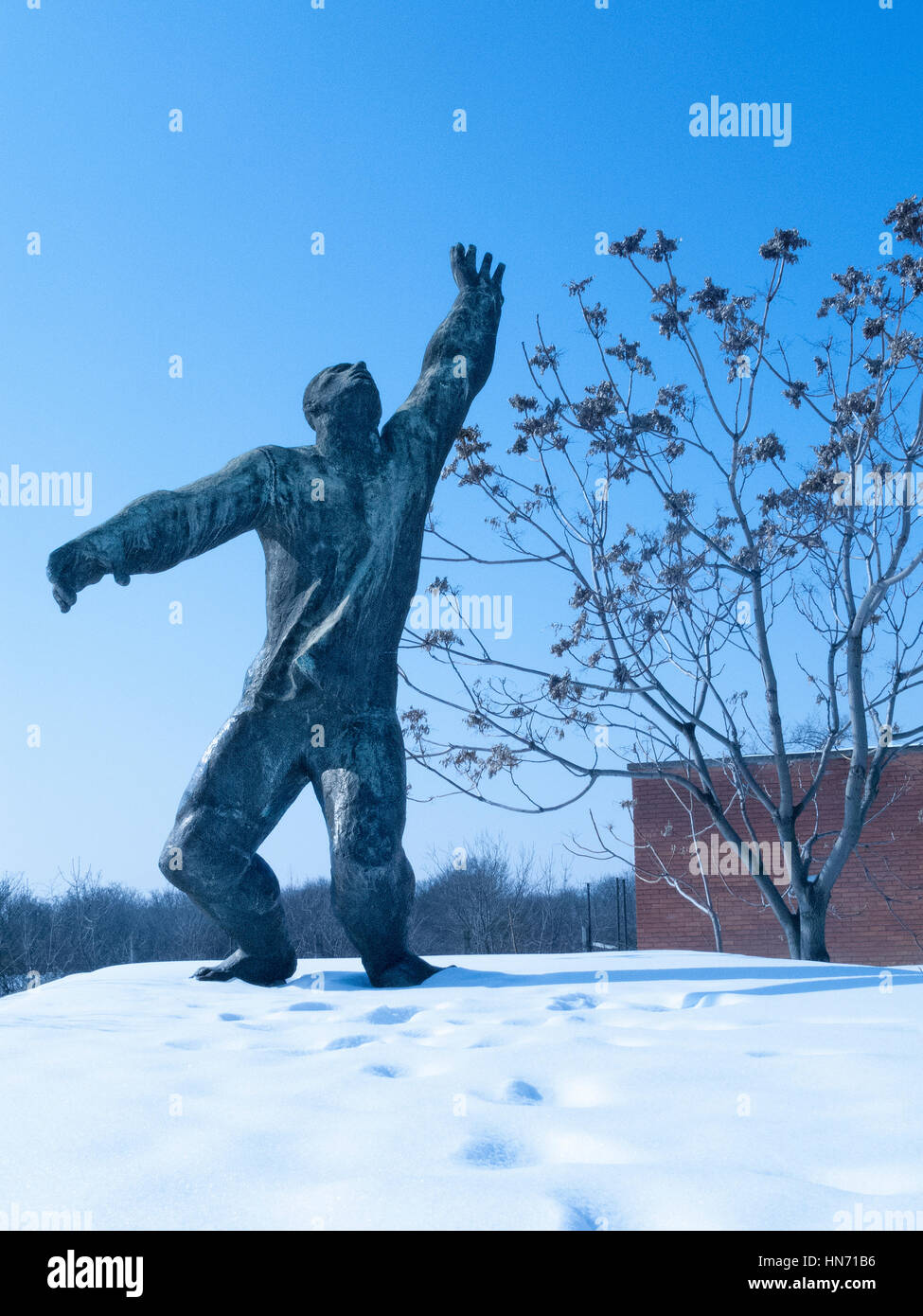 Martyrs Monument, one of the statues in a Snow covered Memento Park, Budapest.. - Stock Image