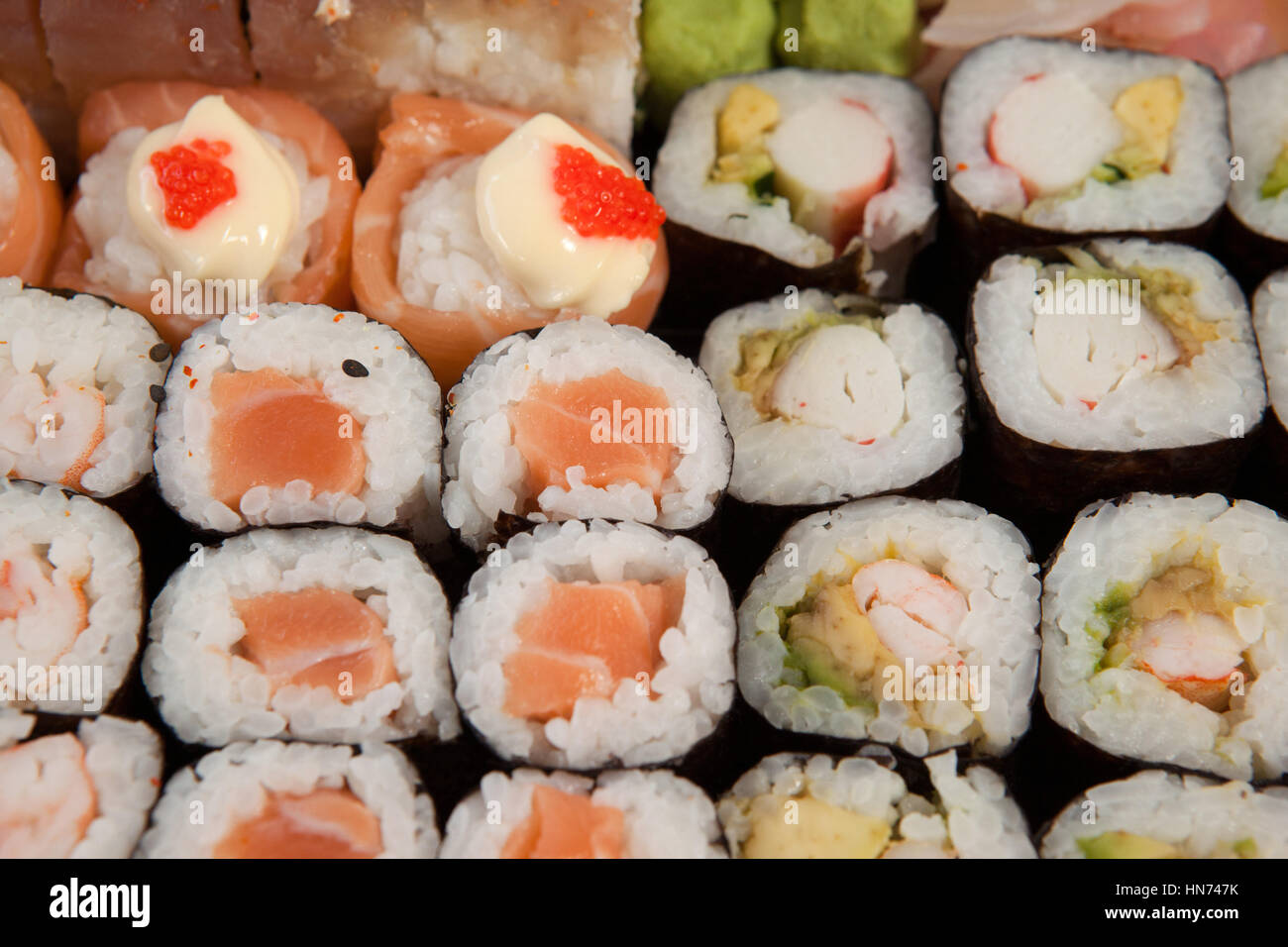 Close-up of set of assorted sushi kept in a black box - Stock Image