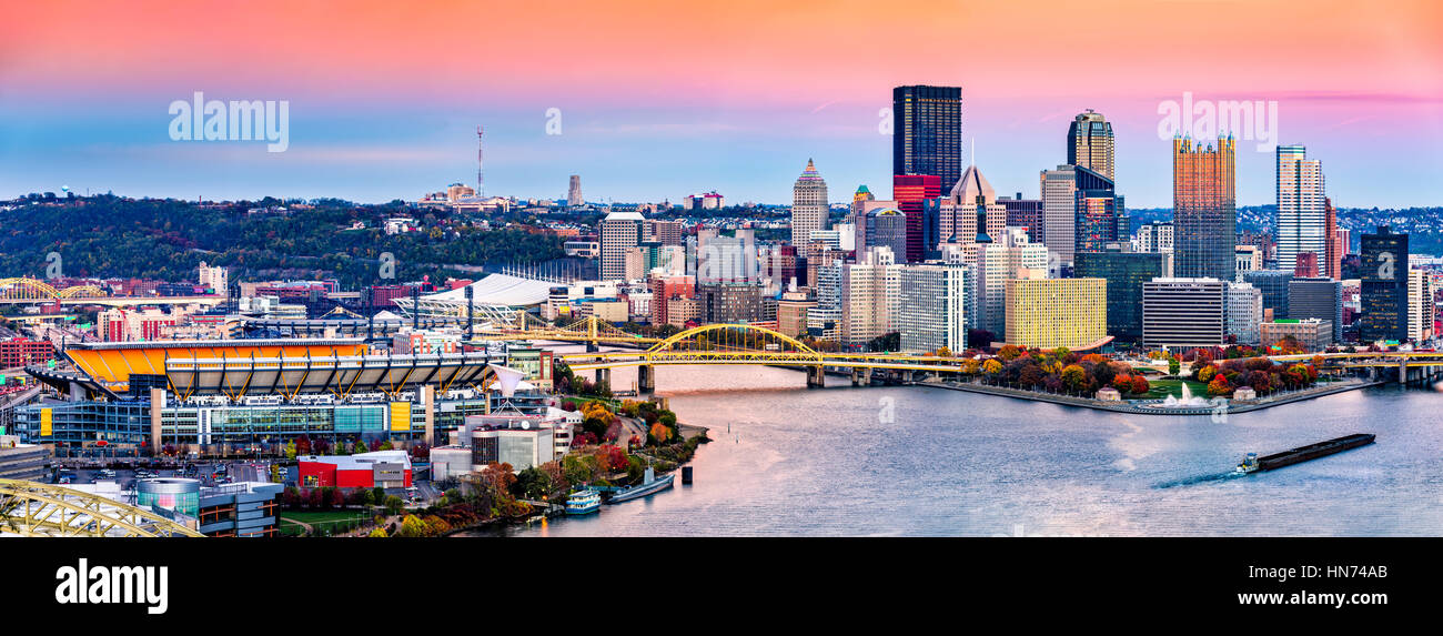 Pittsburgh, Pennsylvania skyline at sunset and the famous baseball stadium across Allegheny river - Stock Image