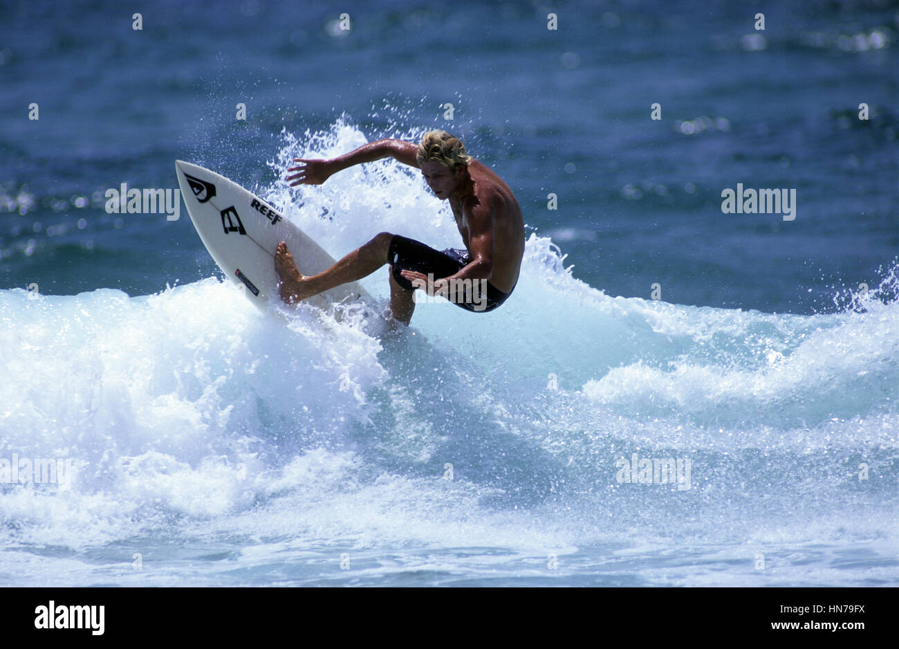 Surferturns off the top of the wave - Stock Image