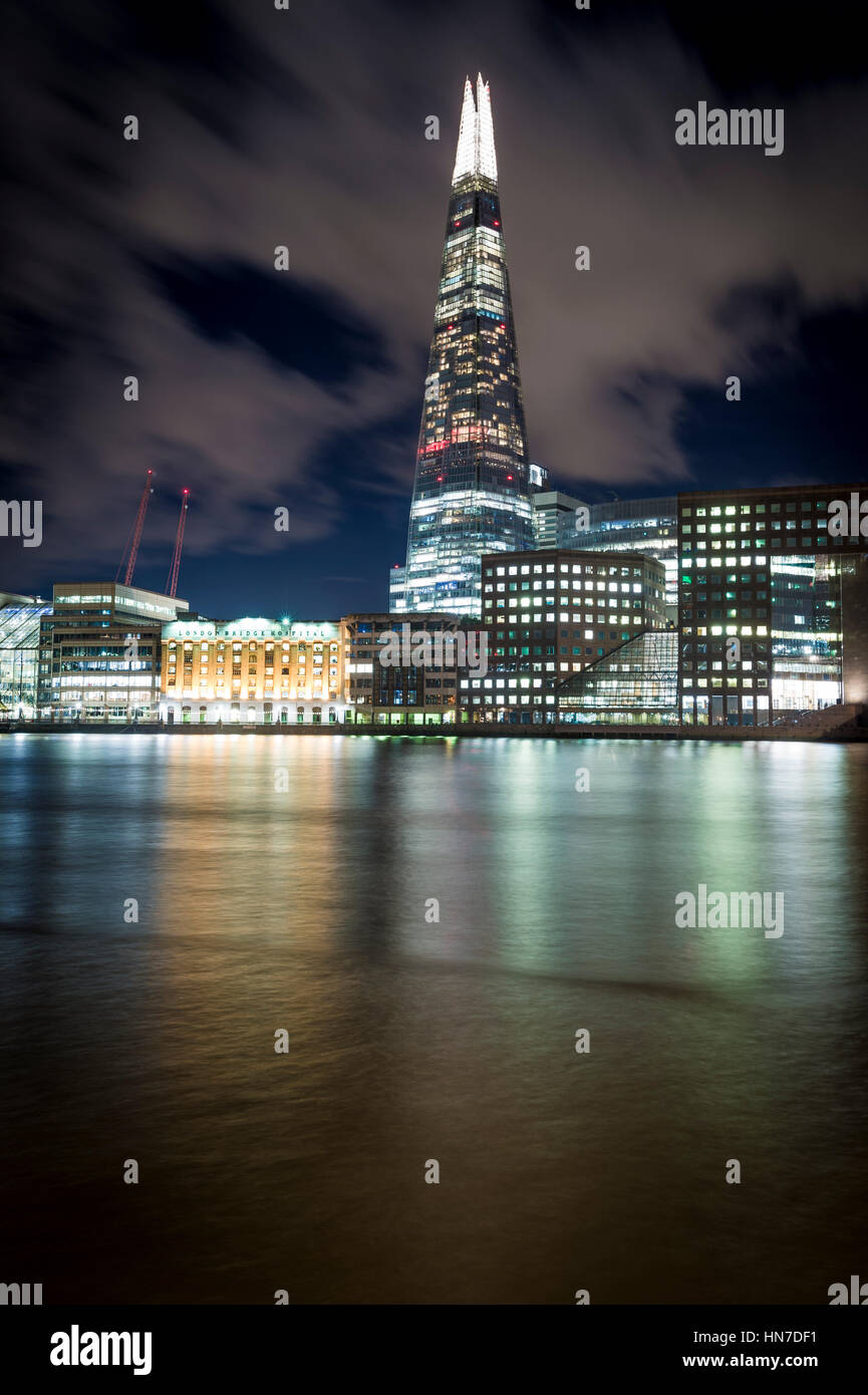 The Shard (Shard of Glass, Shard London Bridge), London Bridge Hospital and River Thames, London, at night. Stock Photo