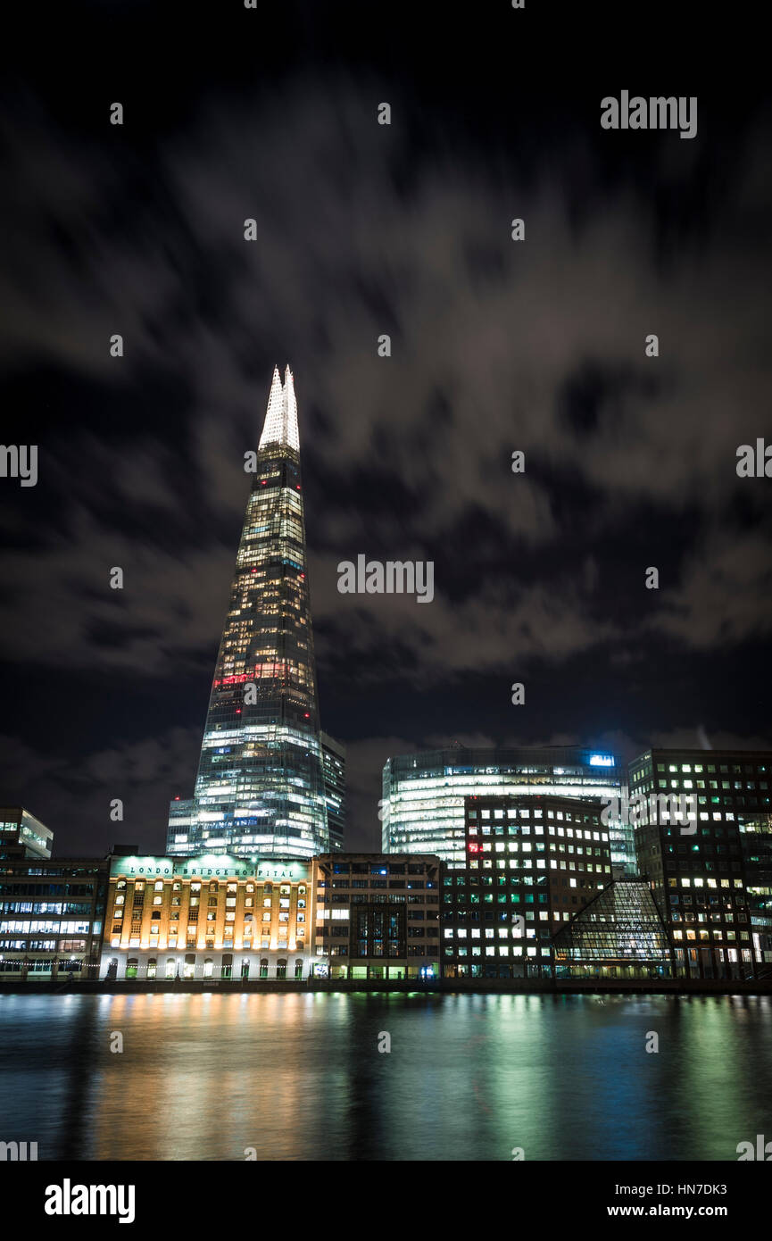 The Shard (Shard of Glass, Shard London Bridge), London Bridge Hospital and River Thames, London, at night. - Stock Image