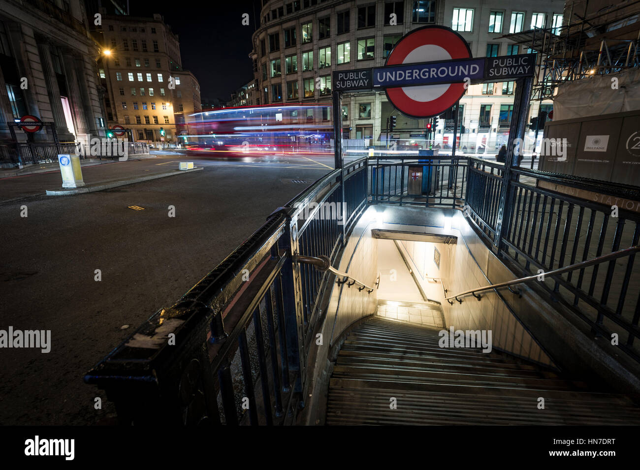 An entrance to Monument London Underground tube station on Cannon Street at night. - Stock Image