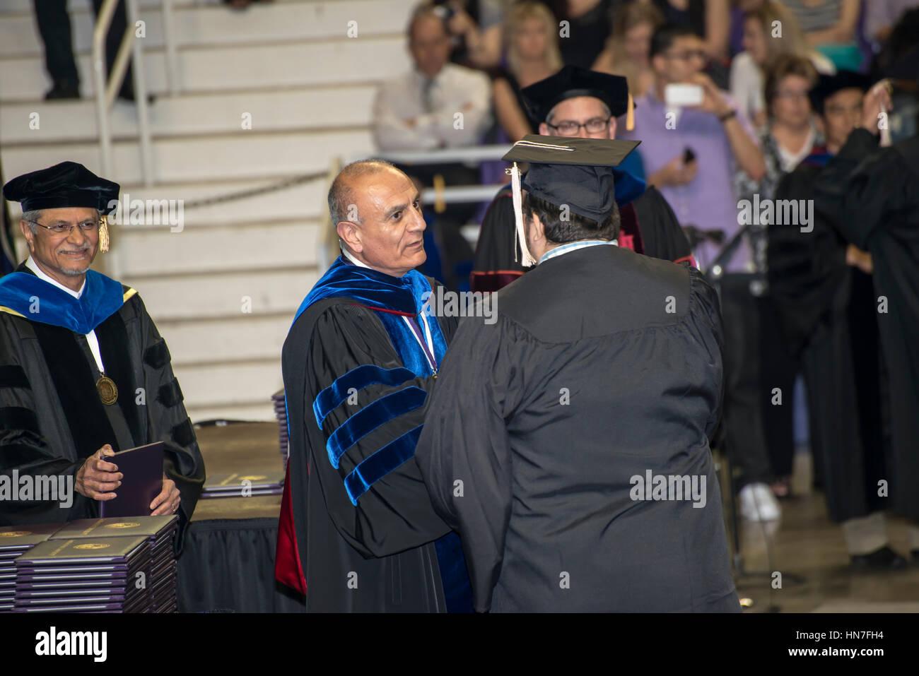 Manhattan, Kansas.  Kansas State University. Graduation ceremony.  Graduate receiving his diploma. - Stock Image