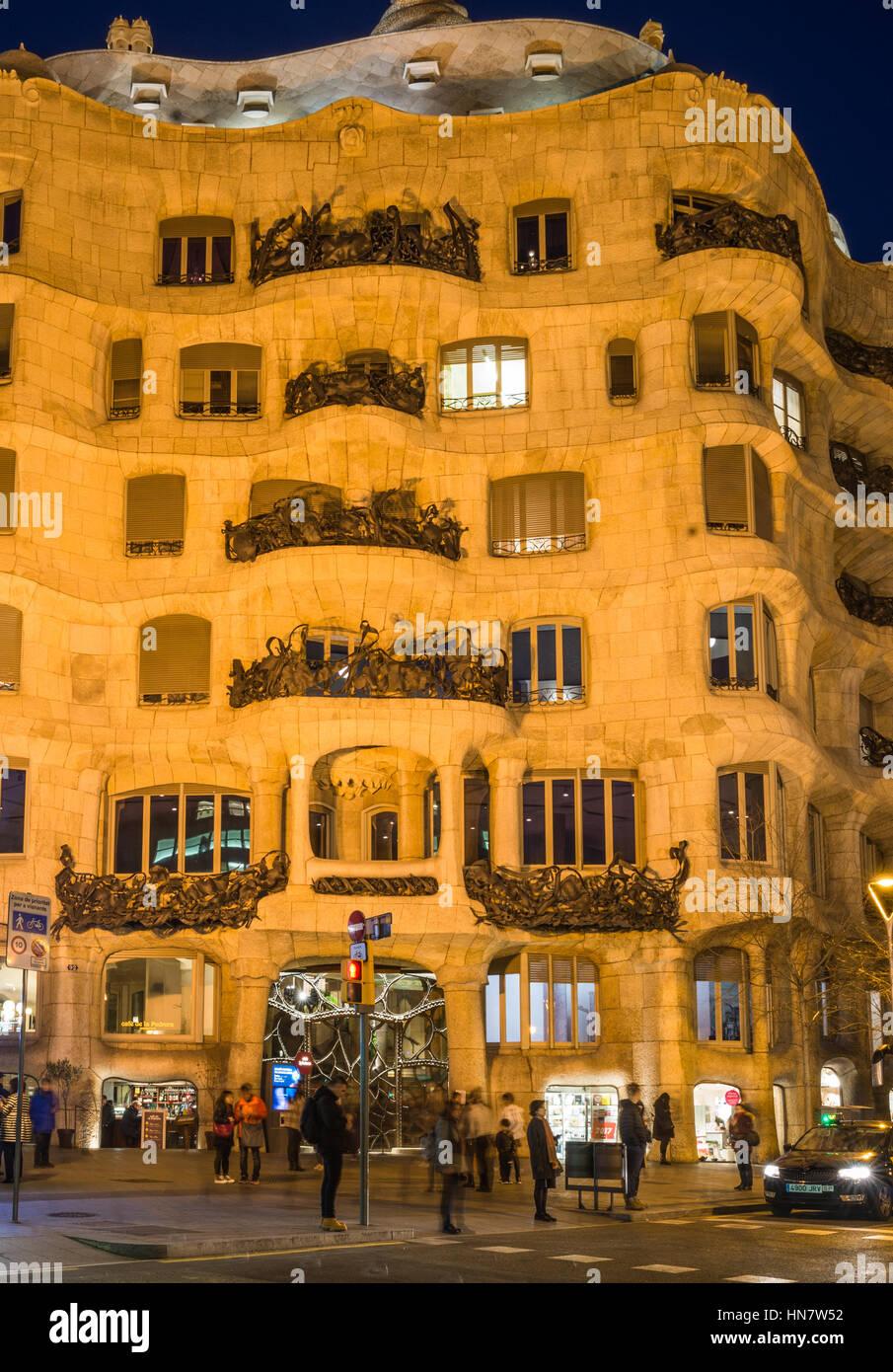 Gaudi's Casa Mila aka La Pedrera after dark, in Barcelona, Spain Stock Photo