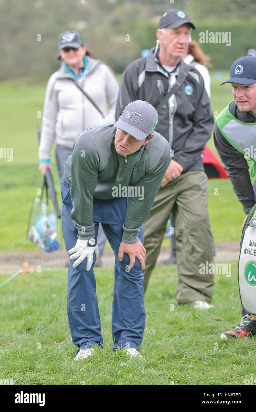 Pebble Beach, California, USA. 9th February, 2017.   Mark Wahlberg, and caddy chat over a tricky shot whilst  competing - Stock Image