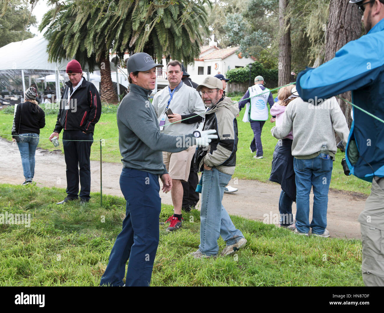 Pebble Beach, California, USA. 9th February, 2017.  Mark Wahlberg clear the gallery whilst looking for his ball - Stock Image