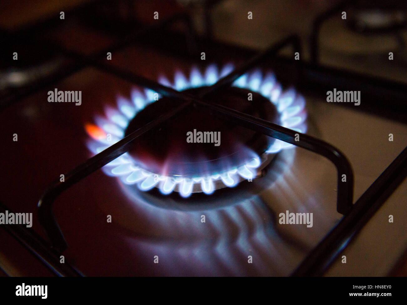 Gas hob cooker flame alight cost of energy UK - Stock Image