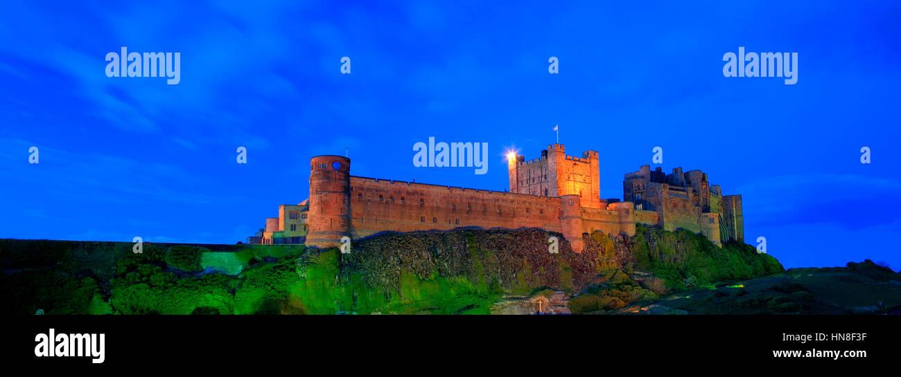 Summer, Bamburgh Castle, Bamburgh village, North Northumbrian Coast, Northumbria County, England, UK - Stock Image