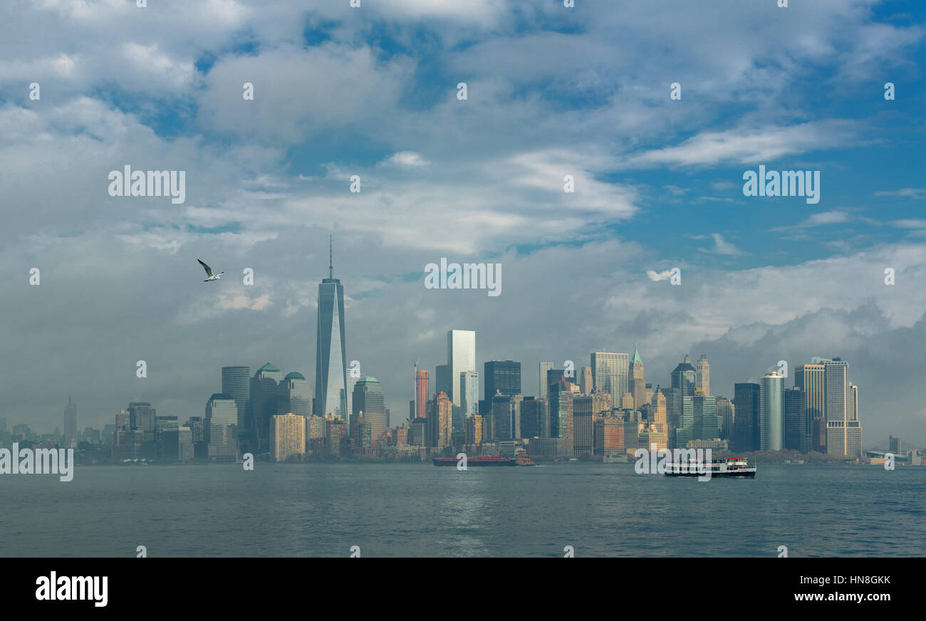 View of Manhattan, New York, on a cloudy day from Liberty Island. - Stock Image