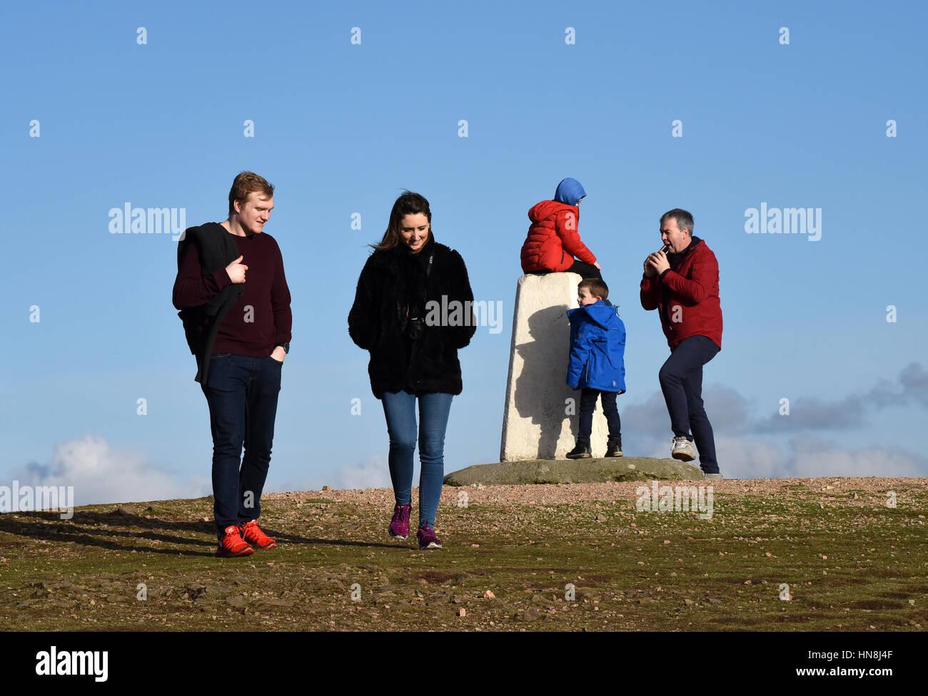 Walkers on the Wrekin Hill in Shropshire Uk - Stock Image