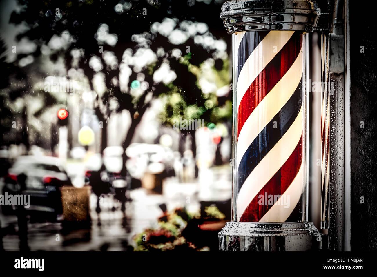 Rain collecting on the barber shop pole at Island Barbers in Coronado, California. - Stock Image