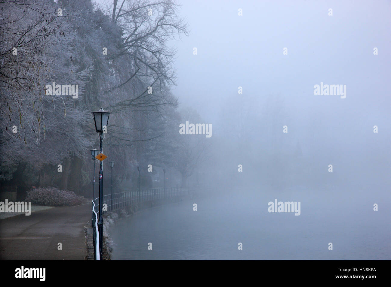 Riverside road by river Aare, Thun town, Bernese Oberland, Switzerland - Stock Image
