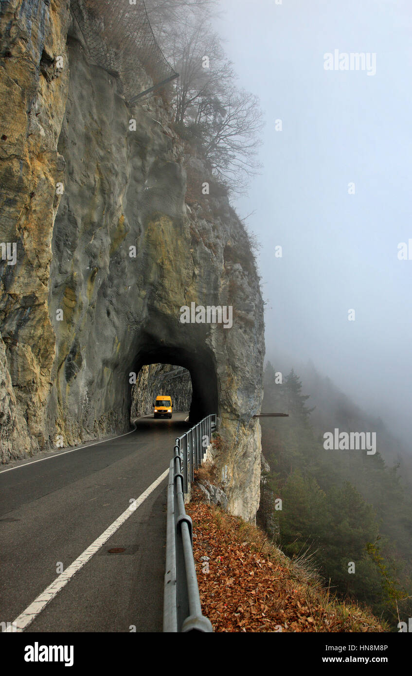 Rocky tunnel on the road south of Thun lake (Thunersee), Bernese Oberland, Switzerland - Stock Image