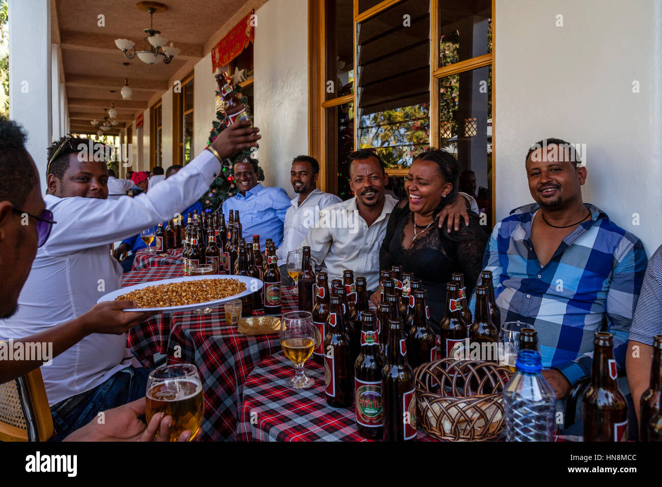 A Wedding Party, Guests At A Wedding Drinking Beer, Lake Ziway, Ziway, Ethiopia - Stock Image