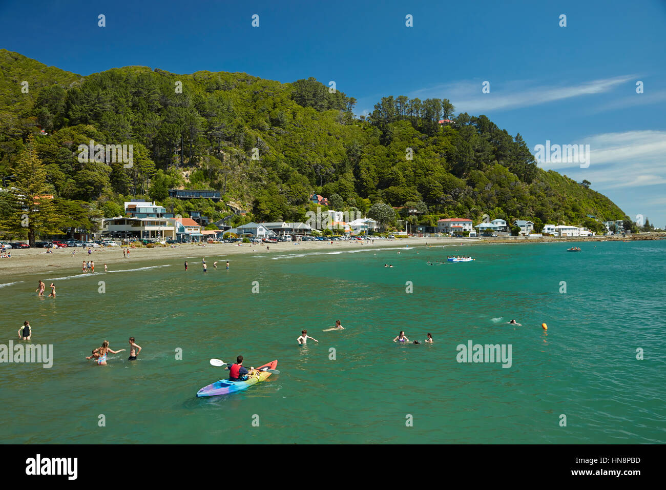 Kayaker and swimmers, Days Bay, Eastbourne, Wellington, North Island, New Zealand - Stock Image