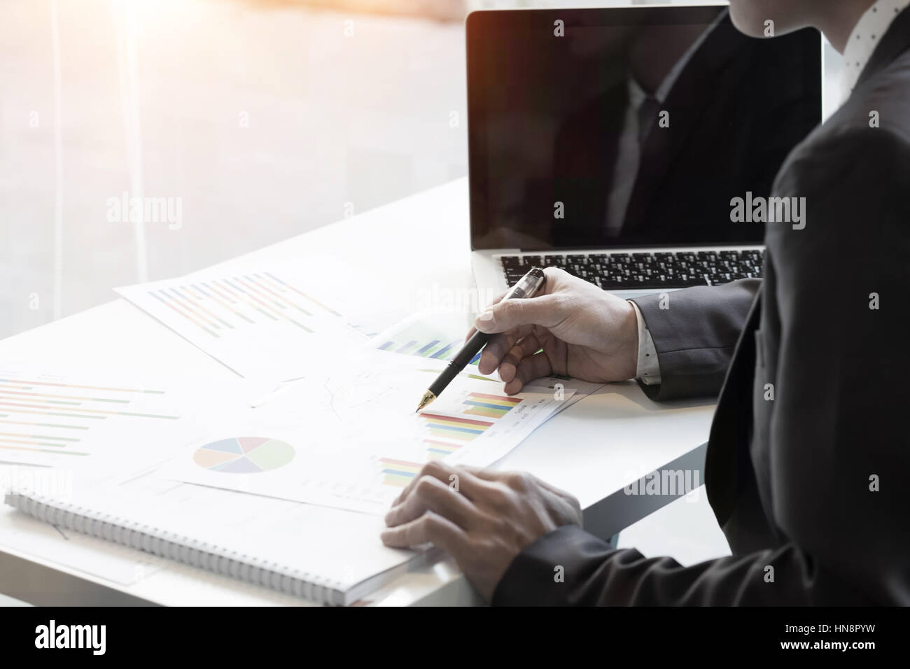 Businessman working in office with vintage tone and selective focus,office life concept. - Stock Image