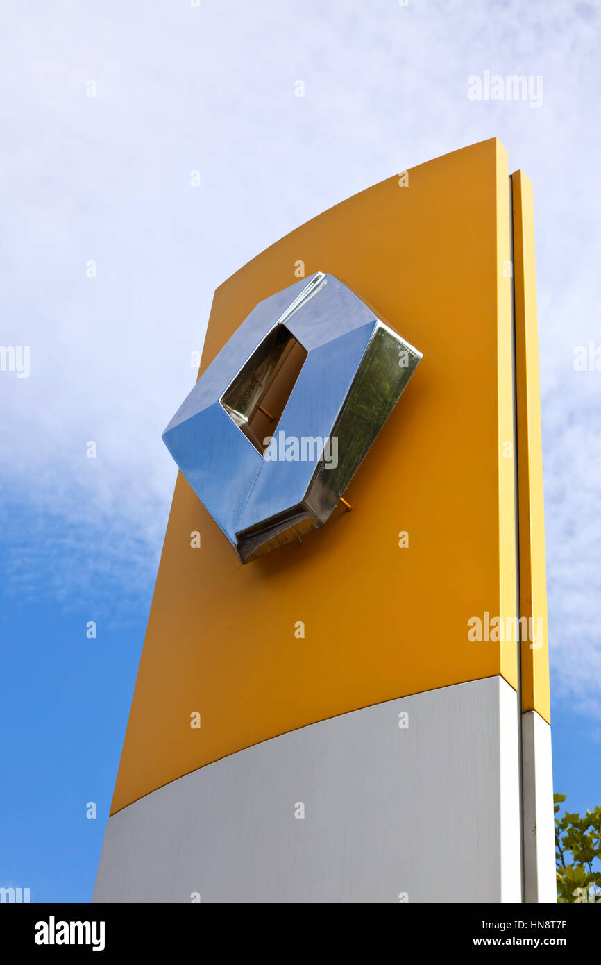 Sign at Renault car dealer's building. Renault S.A. is a french car manufacturer producing cars, vans, buses - Stock Image