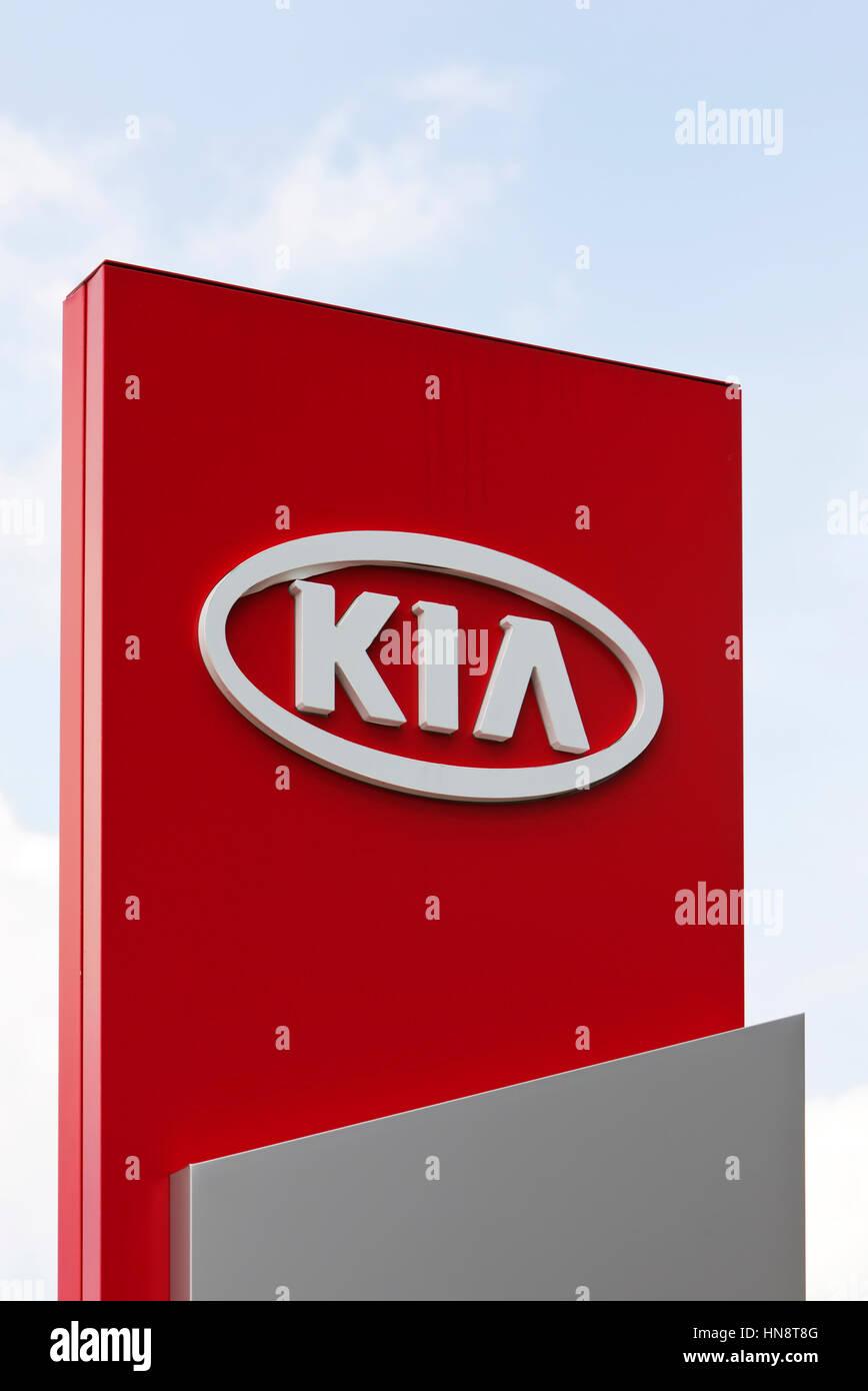 KIA logo at car dealer. KIA Motors, headquartered in Seoul, is South Korea's second largest automobile manufacturer. Stock Photo