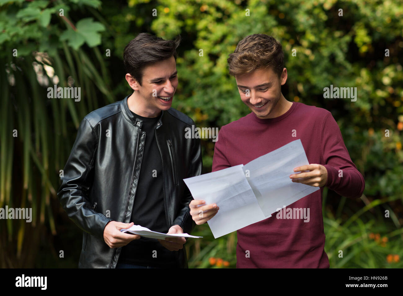 Students opening their results on A level results day in Swansea, South Wales, UK. - Stock Image