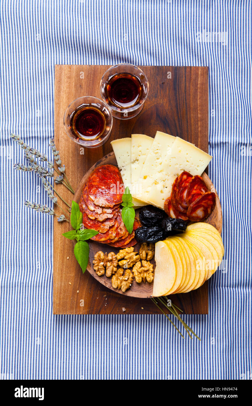 Snacks On A Clay Plate With Wine Marsala On A Blue Tablecloth Stock Photo Alamy