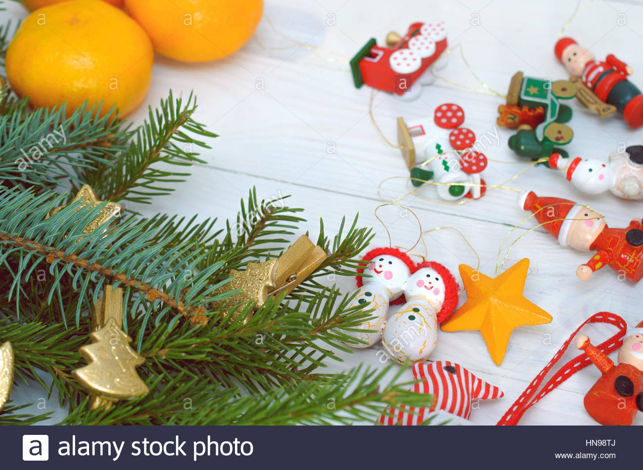 Pine Branches, Christmas Toys And Tangerines On A White Background Stock Photo