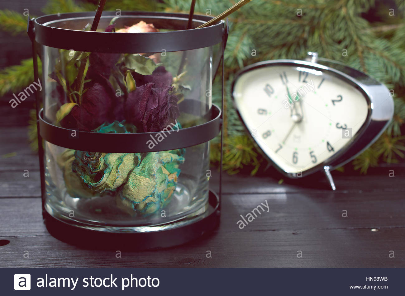 New Year Nostalgia - Dried Flowers And A Clock On A Dark Background - Stock Image