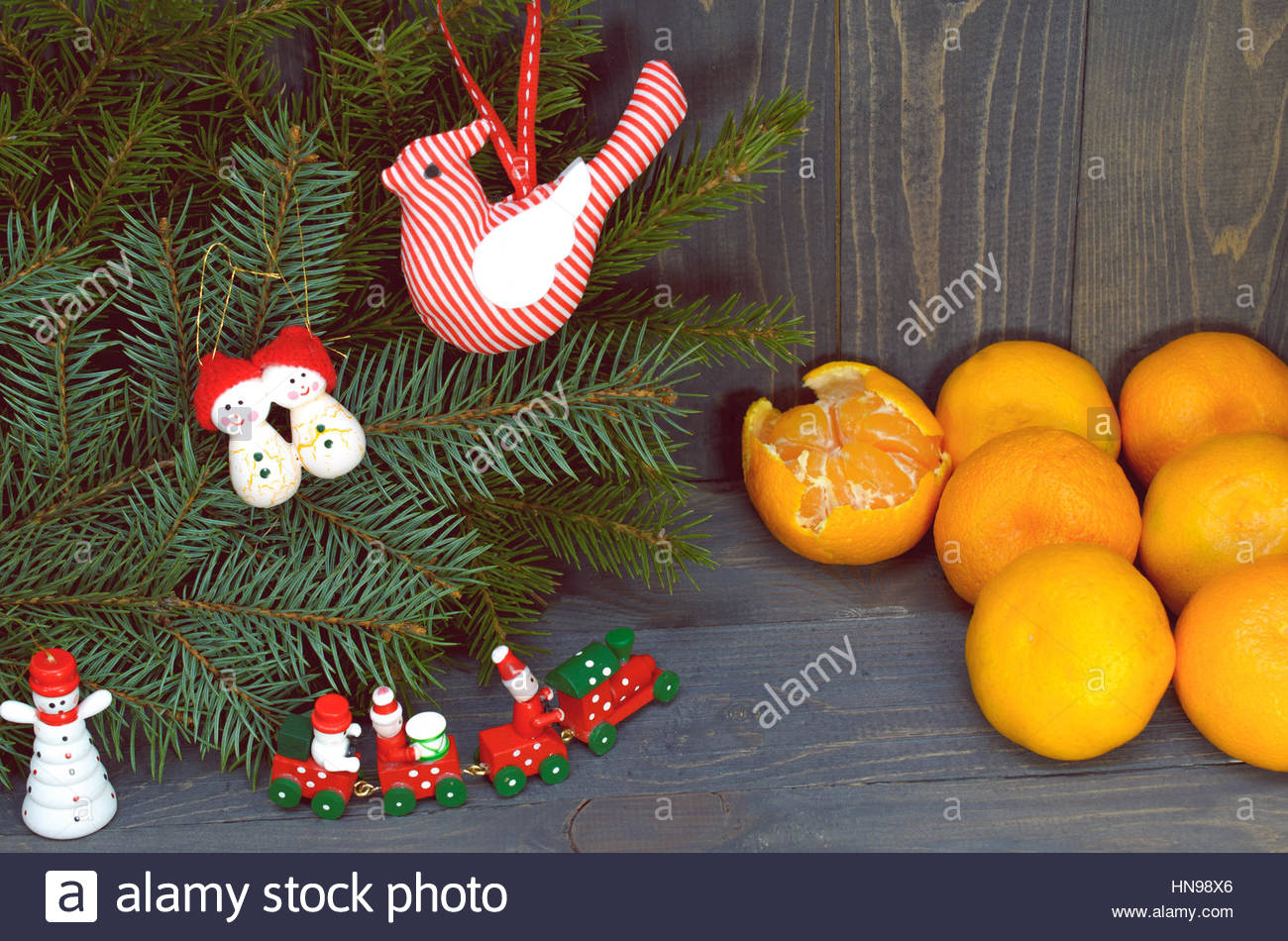 Pine Branches  And Tangerines On A Dark Wood  Background - Stock Image