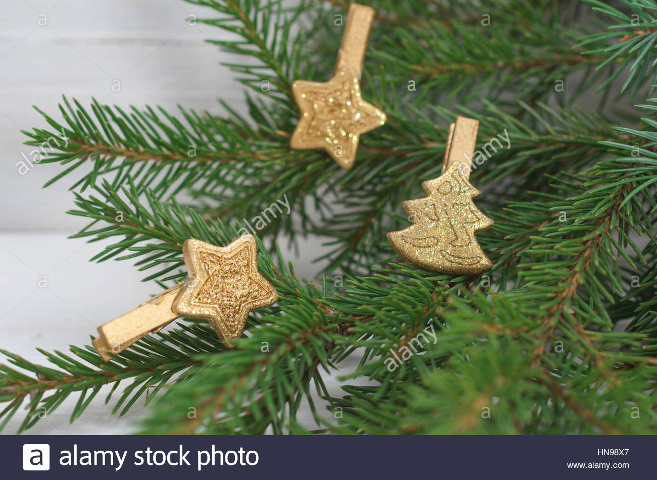 Pine Branches And Wooden Christmas Decorations On A White Background - Stock Image