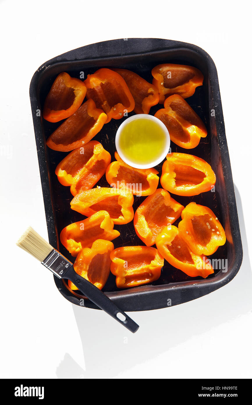 peppers on baking sheet - Stock Image