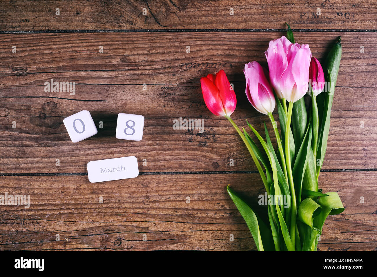 Pink Tulip Flowers On Rustic Table For March 8 International Womens