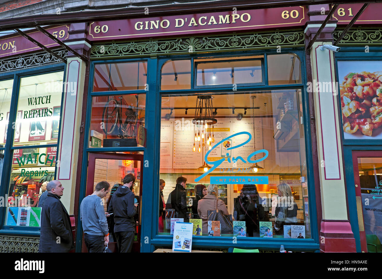 Customers queuing at Gino D'Acampo Italian Pasta Bar restaurant at lunchtime in Leadenhall Market in The City - Stock Image